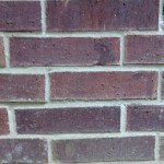 Picture of crooked bricks in wall